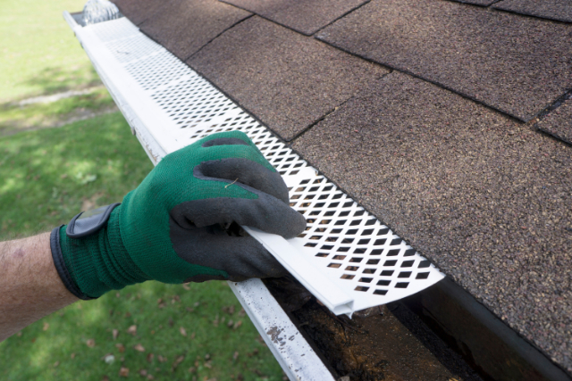 New Gutter Guard Installation in Eugene, OR by worker