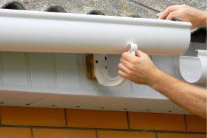 Worker doing Gutter Installation in Eugene