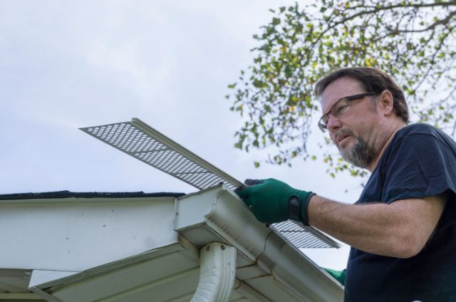 Beaverton Gutter Contractor Examining Plastic Leaf Guard